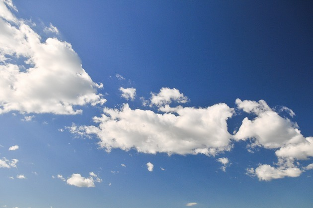 White Fluffly Clouds In A Blue Sky.jpg