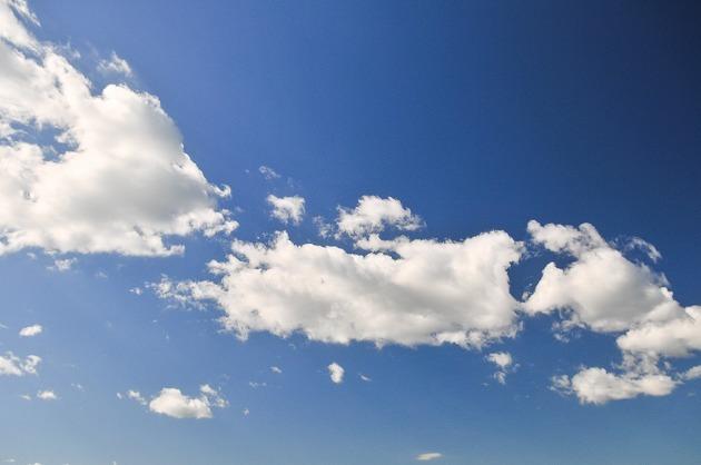 White Fluffly Clouds In A Blue Sky.jpg